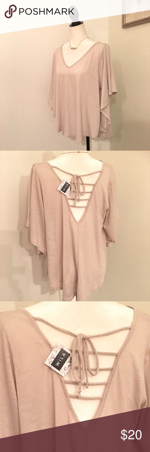 Plunging Tie Back V Neck Batwing Top by WILA NWT Gorgeous V Neck Top by WILA. Batwing sleeves, plunging Tie Back, cream color. Size Small. 55% cotton, 45% Modal. New with tags from my non smoking home 💕 WILA Tops