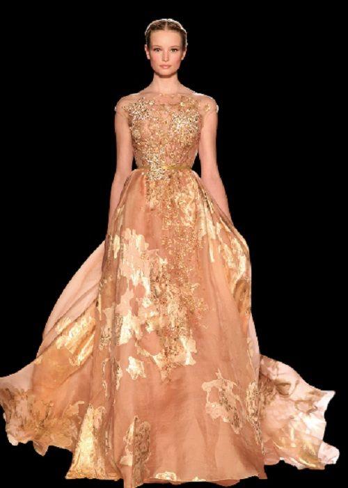 L'oro è un evergreen per la moda: di anno in anno tra i capi che sfilano sulle passerelle non manca mai un modello che ha inserti dorati. Non è così per la moda sposa che predilige da sempre il bianco e colori più tenui. Ma nell'anno in cui il matrimonio si tinge di rosso grazie a Vera Wang, perchè non scegliere l'oro come trend per il vostro matrimonio e, perchè no, per l'abito da sposa?
