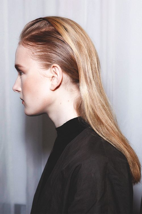 80s inspired slicked back runway hairstyle