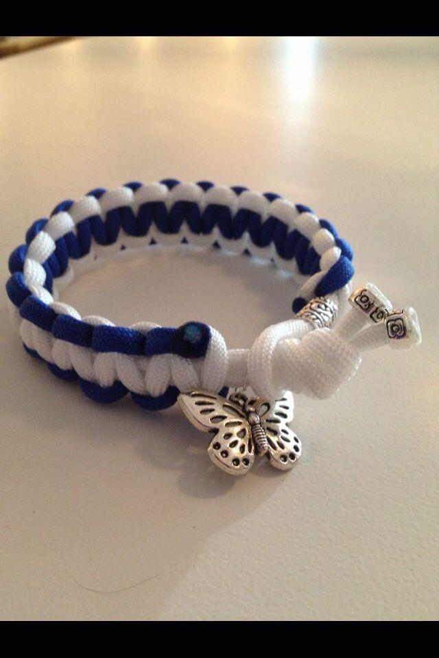 Paracordarmband enkel knytning. SHL -Leksands färger, med fjärilsberlock och beads.