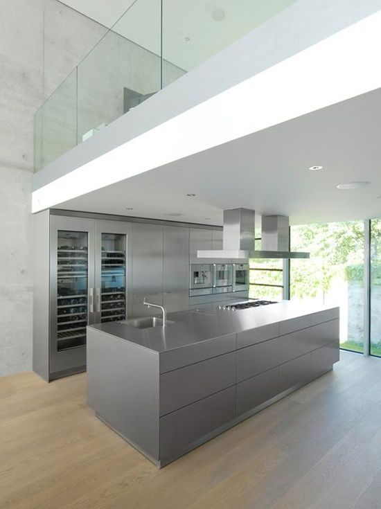 Minimal grey kitchen island / wooden floor / entresol