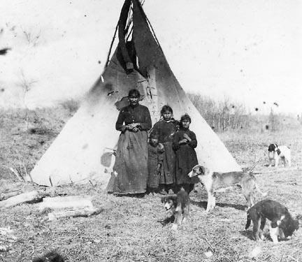 Beaver woman and children near Peace River, Alberta - no date