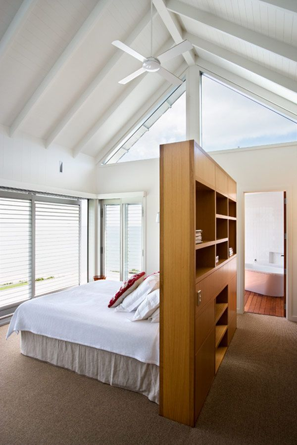 like the wall separation from bathroom.. Bedroom Design - From a beach house in New Zealand designed by architects Crosson, Clarke, Carnachan. | #Bedroom #Interiors #InteriorDesign .....a good solution for a straight line to the master bath.