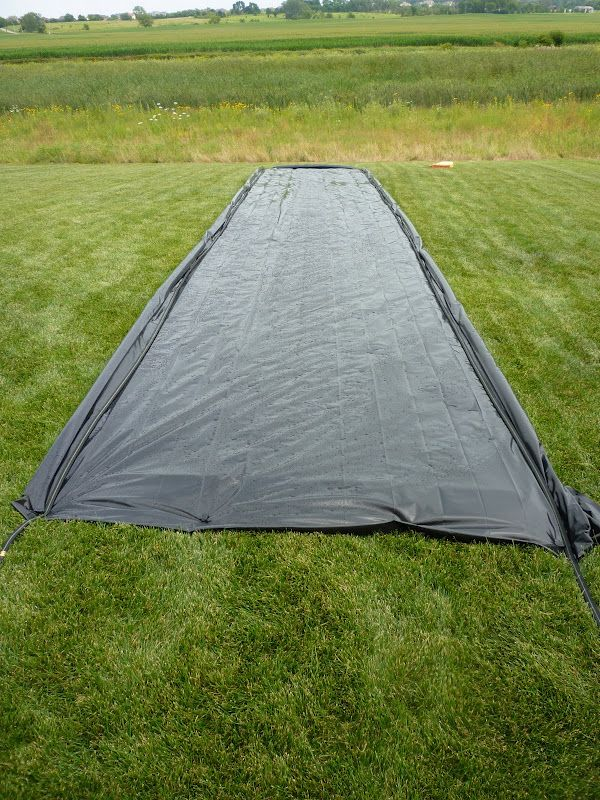 What I wouldn't give to have had my parents make me this growing up!! Best DIY slip-n-slide ever.