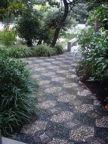 Mosaic pebble path. Pinned to Garden Design - Paving & Stairs by Darin Bradbury.