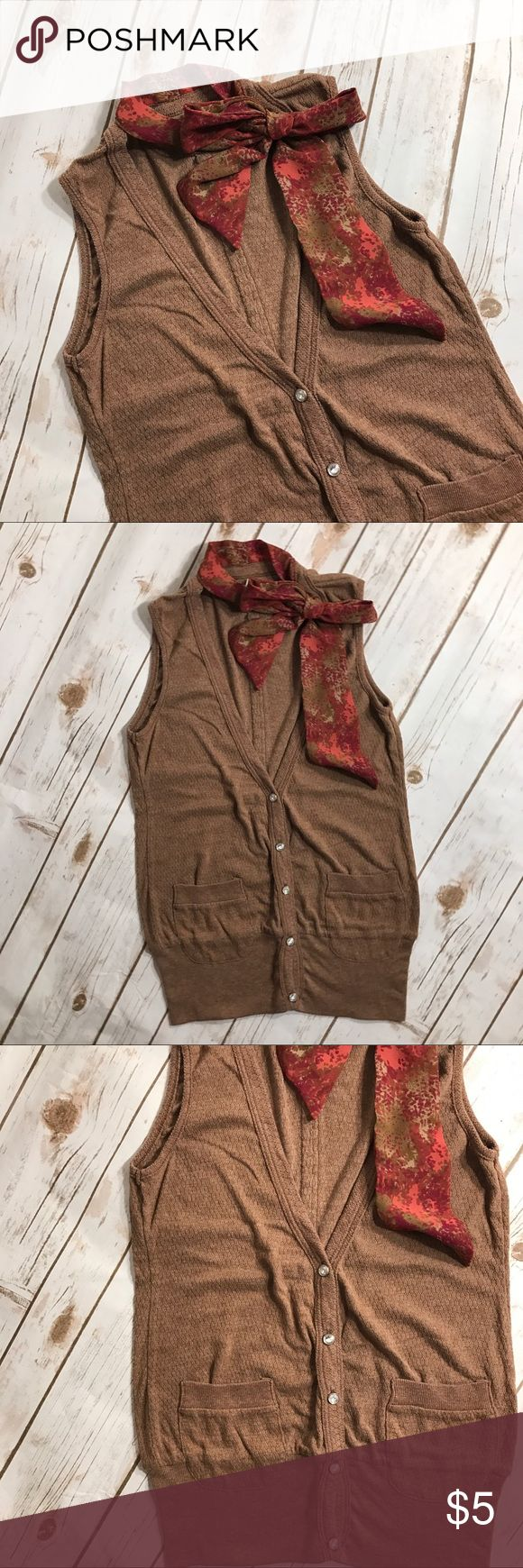 """Charlotte Russe brown vest Super cute brown vest with wax diamond buttons. Attached collar has scarf like look to tie as a bow. Measurements for flat lay: Shoulder to Shoulder (12"""") Armpit to Armpit (12"""") Top to Bottom (25"""") Charlotte Russe Tops Blouses"""