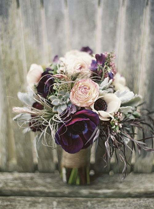 A purple wedding bouquet with white anemones | Brides.com