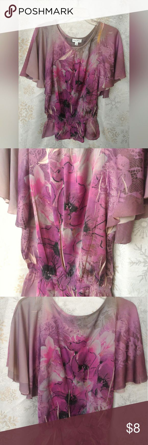 Purple/pink Floral Short Sleeved Tunic Pretty flouncy, flowy sleeved top. Gathered/cinched at the bottom. studio works Tops Tunics