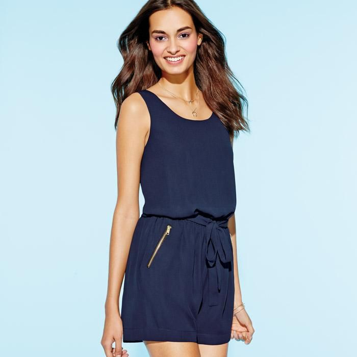Warm weather's ultimate throw-on-and-go piece returns in a dress-it-up/dress-it-down navy chiffon with an attached sash and pockets that add some zip. Polyester. Imported.