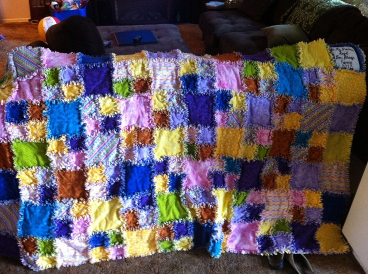 The Rag quilt. My first one. Oh my what a lot of clipping on a queen size one..