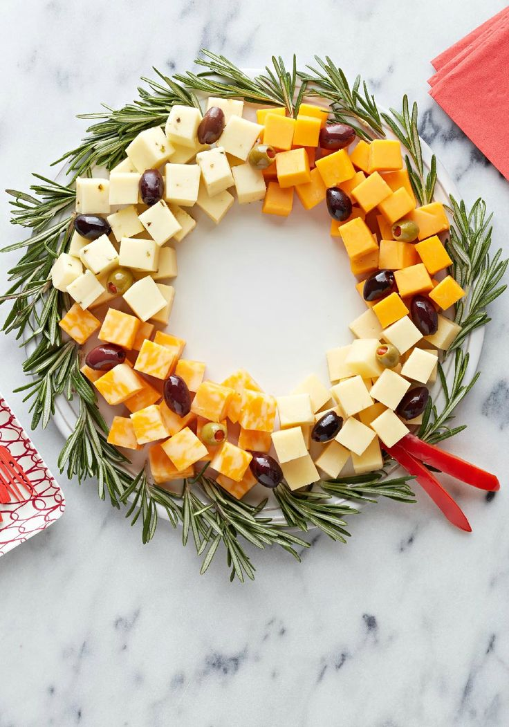 Easy Cheese Wreath – Arrange a variety of delicious, creamy cheese cubes in a circle, add olives, and you've got yourself a simple, elegant appetizer recipe.