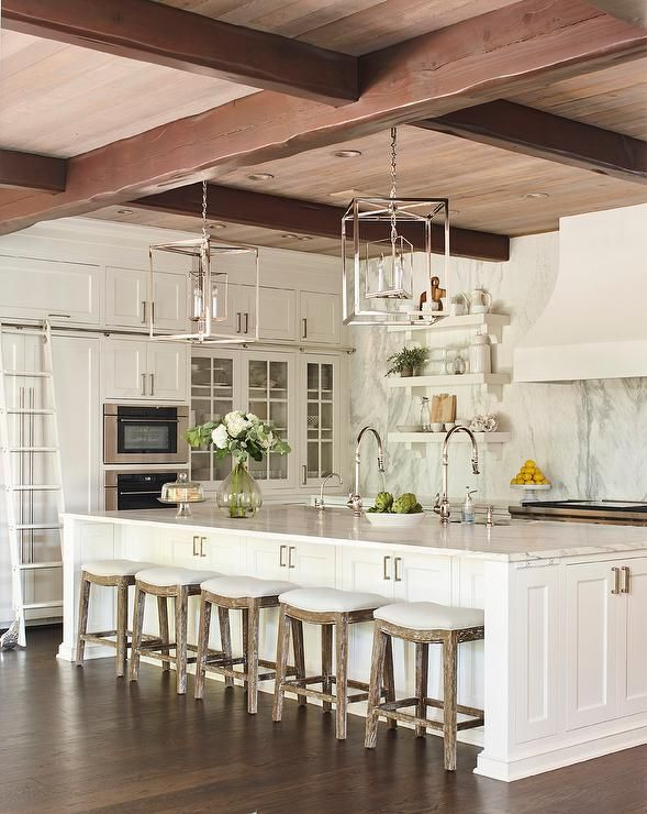 Five Oak Stools Sit At A Long White Kitchen Island Fitted With A White Marble Countertop Kitchen With Long Island Kitchen Island With Sink White Kitchen Island