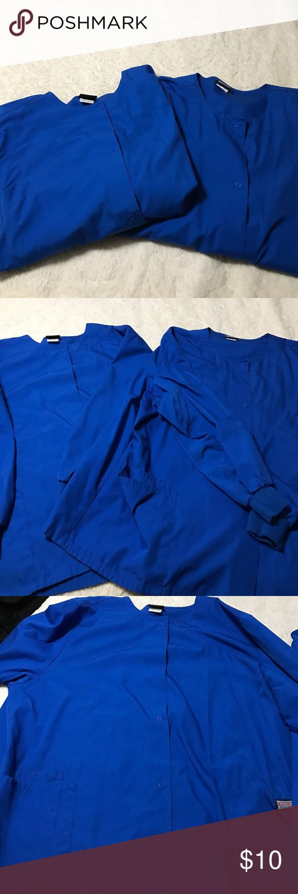 Two button down scrub jackets Cherokee size 2x Two blue button down scrub jackets Cherokee workwear size 2x. Great used condition. Hardly worn. Cherokee Jackets & Coats