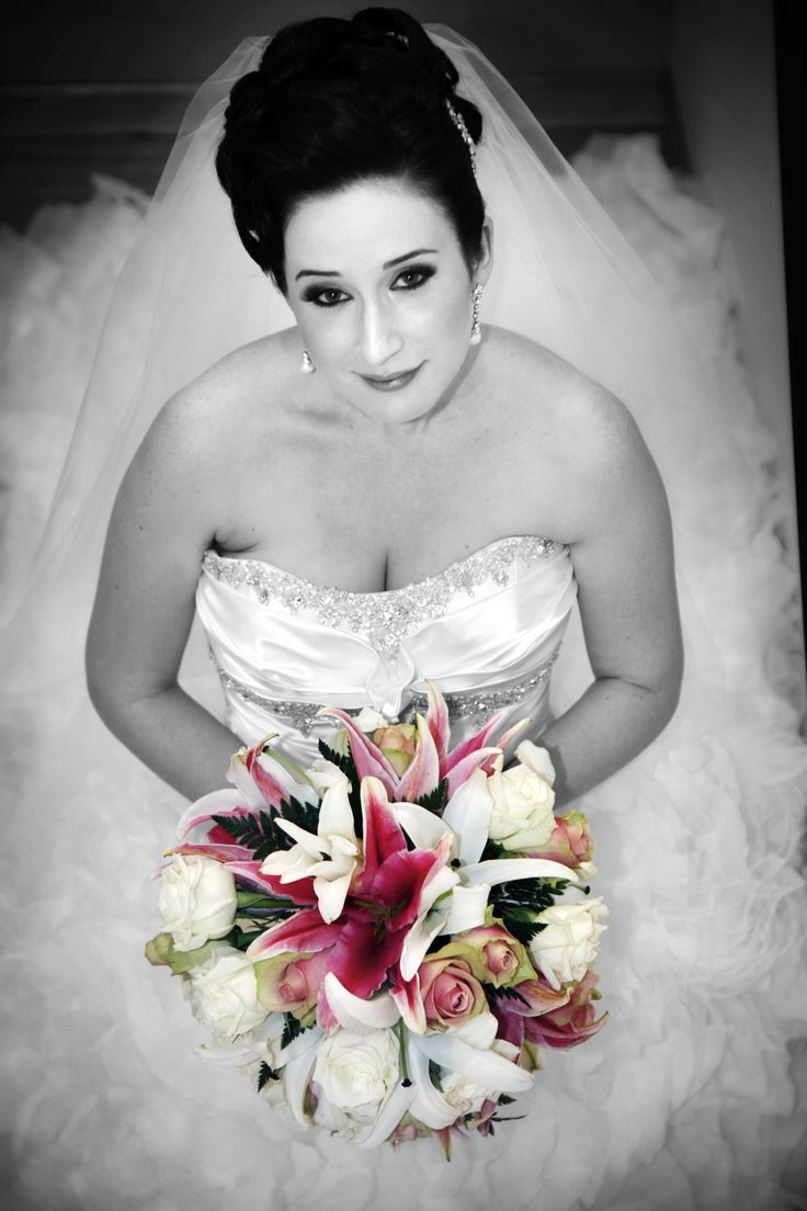 Timeless Audrey Hepburn style French roll with top pin curls  by Total Brides hair & makeup