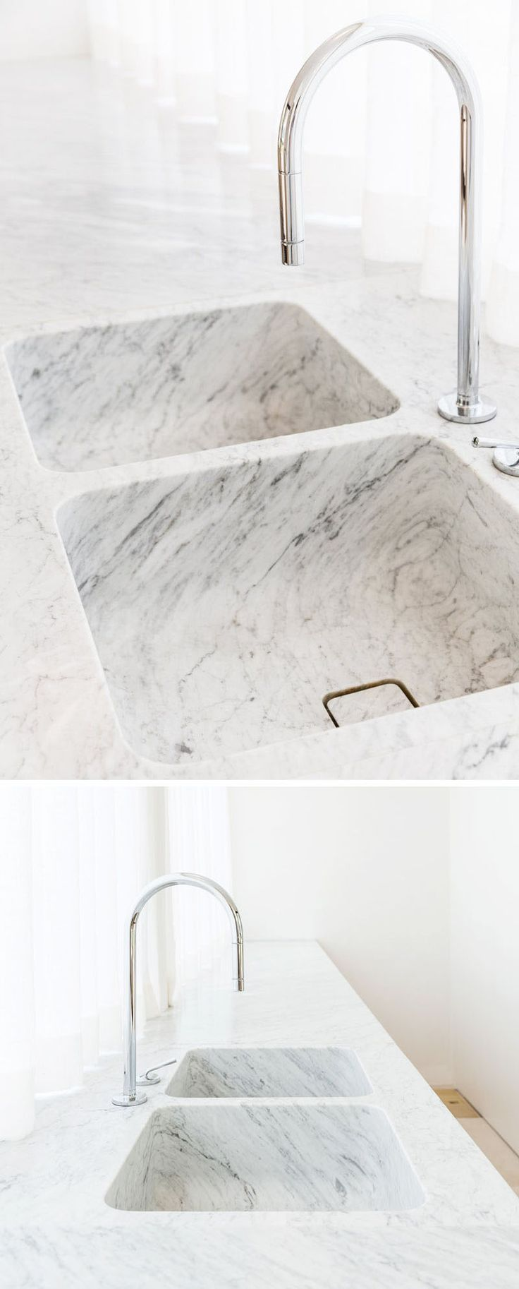 Kitchen Design Idea - Seamless Kitchen Sinks Integrated Into The Countertop // These two integrated sinks showcase the beauty of marble by allowing the striations to continue from the countertop down into the base of the sink.