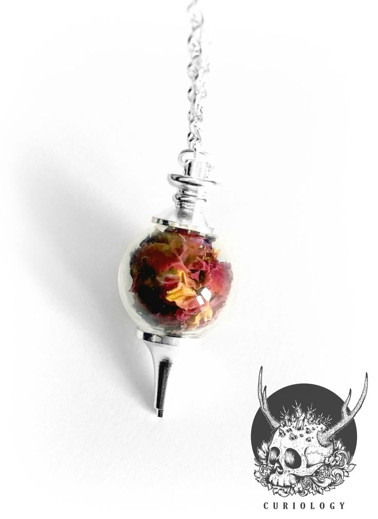 Material - Glass, metalGlass and silver pendulum with real rose petals.Pendant size 5cm/2 inchesStandard option - silver nickel free 18 inch chain.Chains can now be upgraded to sterling silver. Please visit the Chain Upgrades section to add this to your order.Prices are as follows...16 inches   £5.0018 inches   £6.0020 inches   £6.50Black organza necklaces or faux leather cords can be added for no extra charge on request. Please leave us a note if you require this service.Manufactured by…