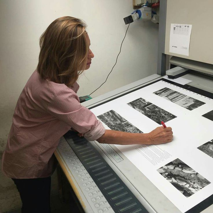 Anna Roma Friedlander while signing sheet for SPQR Editions