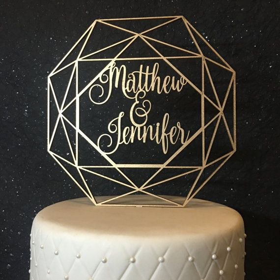 """www.psweddingsandevents.com  This listing is for 1 """"custom geometric cake topper"""" cake topper made of 1/8"""" thick, recycled eucalyptus board. The cake toppers wording is approximately 7"""" wide and 7"""" tall. The sticks that go into your cake are approximately 2.5"""" tall. This cake topper is available in: gold, gold glitter, sliver, silver glitter, rose gold, rose gold glitter, black and DIY (unpainted). If you order a painted cake topper it will come painted on both sides. We hand airbrush all…"""