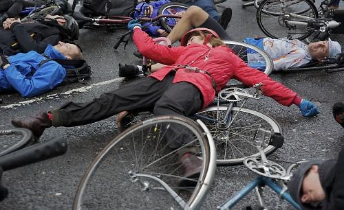 Cyclists converge on Addison Lee's offices in 'Die-In' protest..