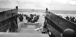 D Day, WWII Image: US troops wade from landing craft toward Omaha Beach during the Normandy invasion on June 6, 1944 (© Robert F. Sargent/US Coast Guard/Time Life Pictures/Getty Images)