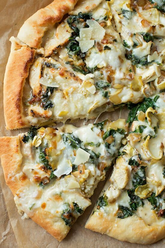 This Spinach Artichoke Pizza is topped with a creamy garlic white sauce, mozzarella, chicken, spinach, and our favorite -- artichokes!