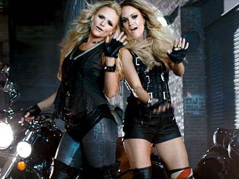 Miranda Lambert and Carrie Underwood work big hair and moto style in the Somethin' Bad video