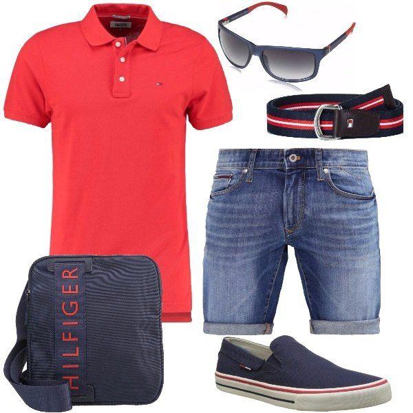 Total look per gli appassionati del brand Tommy Hilfiger formato da una polo di cotone rossa, un paio di pantaloncini di jeans, una borsa a tracolla e un paio di slip on di tela blu scuro. Gli accessori che completano l'outfit sono una cintura di cotone blu, rosso e bianco e pelle marrone e un paio di occhiali da sole con montatura blu e rossa.