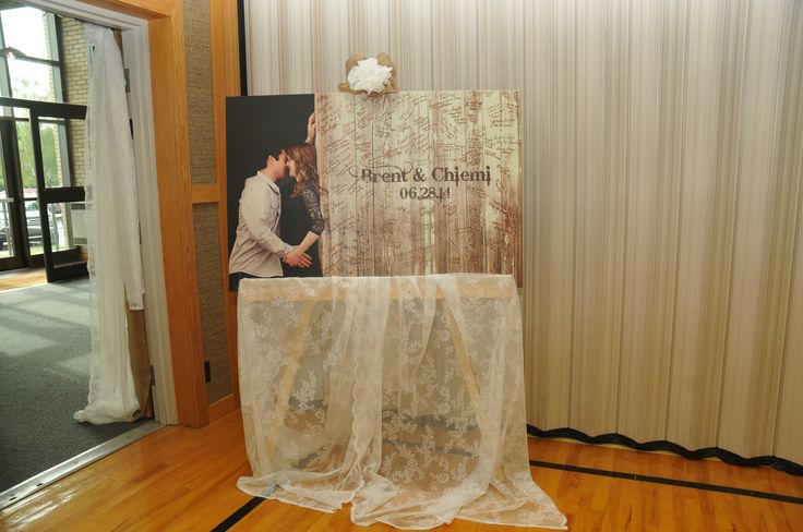 guest book on stand covered in lace