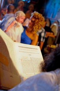 The Holy Bible read by the Priest  - gorgeous little Christening girl and her Godmother in the background -Kremasti Monastery - Greek Orthodox Church - 1700 AC - Photography Con Tsioukis - ICON PHOTOGRAPHY MELBOURNE - www.iconphotos.com.au