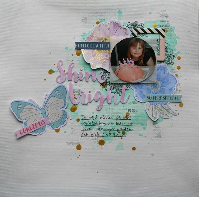 Scrapbook page in pastel colours. Die-cut embellishments and misted background