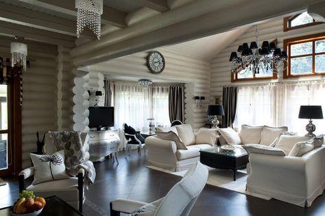 Бревенчатые дома прекрасны и уютны. Есть в них что-то фундаментально-историческое, связь времен, народные традиции... Их строят с размахом, с большими помещениями, на большую семью, чтобы все удобно разместились. Сами собой возникают слова 'терем', 'хоромы' и совершенно естественно, что некоторые обладатели таких домов выбирают русско-народный интерьер с мебелью под русскую старину — тяжелую, добротную, деревянную.