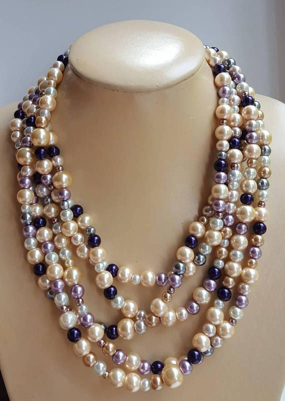 Check out this item in my Etsy shop https://www.etsy.com/ca/listing/551553101/multistrand-colorful-pearl