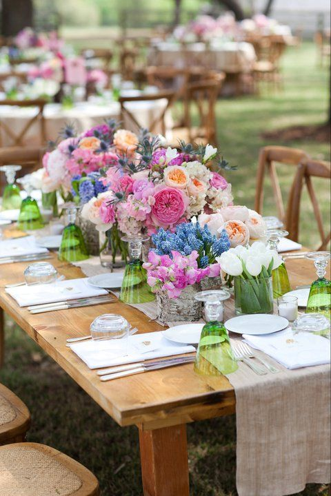 "Simple wooden tables with cloth runners need colored glass and LOTS of rich flowers to bring in the ""wow"" factor (#colorful weddings, #rustic weddings, #spring weddings)"
