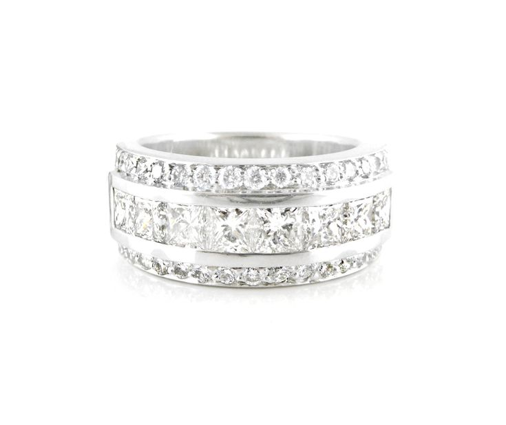 An 18ct White Gold Diamond Eternity Ring with Princess and Round Cut Diamonds