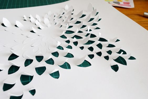 A paper cutting and curling work of Renee Riotto's in progress.  #renee #riotto #reneeriotto #paper #cutting #craft #art #white #artwork #create #creative #blog #inspo #inspiration #delicate #paperart #papercraft #papercut #papercutting