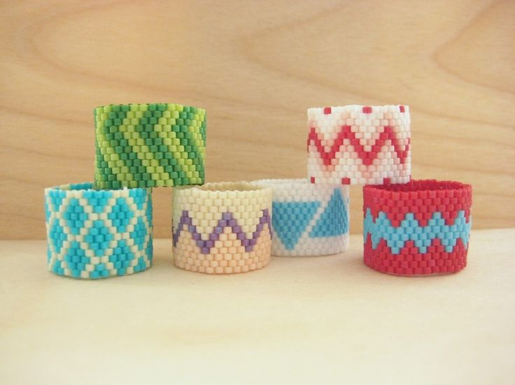 I think I can make these - peyote rings with patterns, has pictures and text.   Beaded Rings - How Did You Make This? | Luxe DIY