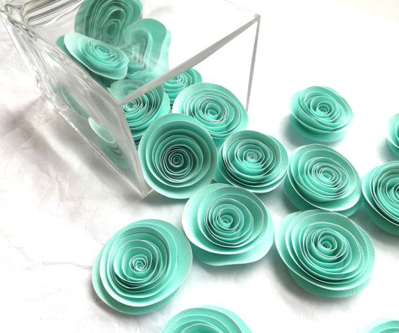 You will receive a total of Twenty (20) Mint Paper Flowers as pictured. Each flower is hand cut and hand rolled in our smoke-free home studio and it