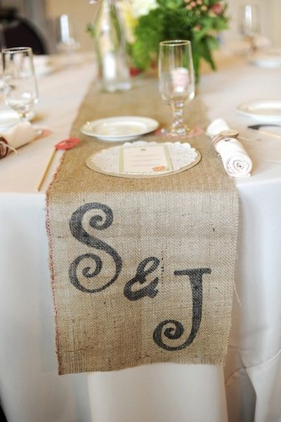 Burlap runners with a stenciled monogram-- this would be so inexpensive and easy to do for your rustic chic wedding!