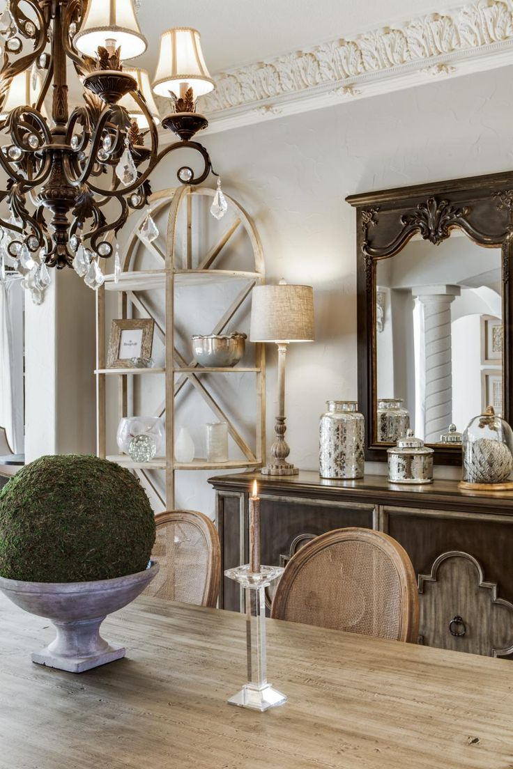French country dining room chandelier - A Farmhouse Style Dining Table Pairs With An Elegant Brown Buffet A Traditional Chandelier French Dining Roomstraditional Chandelierscountry