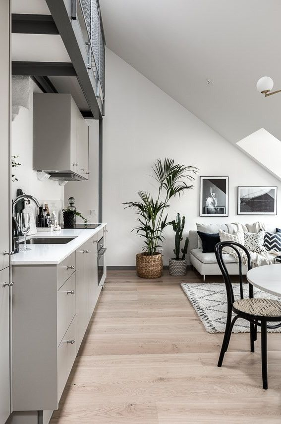 600sf attic apartment | Small house living with modern, minimalist decor | Dormer windows provide lots of daylight.