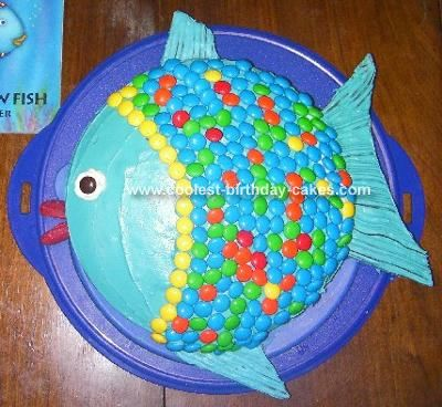 Pretty easy to make.  I used rice krispie treats for the fins.  You need to buy two big bags of m's to get enough blue pieces, but the extras minus the blues look like fall colors.  The kids loved this cake after FHE.  We read rainbow fish and talked about sharing and how it's who you are on the inside that makes you really beautiful.  Fun night.