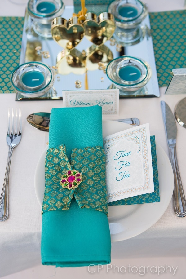 Agra Dreams table accessories in teal and gold inspired by the architecture of the Taj Mahal in India.  These decorative special touches are perfect for Asian weddings or celebrations.  Available in many colours by www.fuschiadesigns.co.uk.