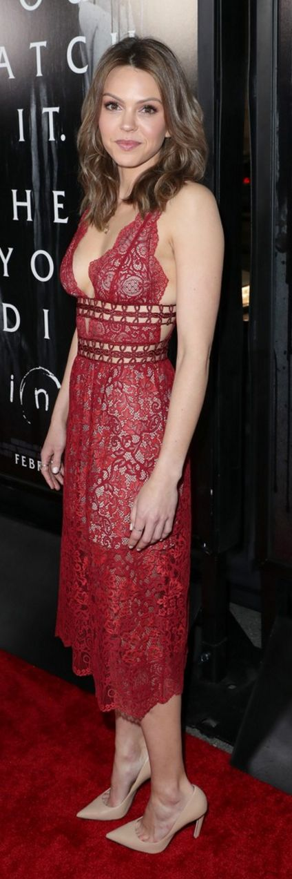 Who made Aimeé Teegarden's red lace dress?