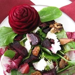 Beet Salad with Goat Cheese. Id probably do this without the candied walnuts or orange juice, and mix in some spinach and beet greens for the salad greens. (link is to this picture, click the recipe title to get to the recipe)