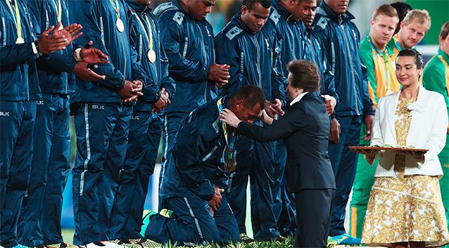 They may be big and burly but the Fijian rugby team have shown their gracious side, humbly bowing down before Princess Anne to accept their gold medals after an incredible win in the men's rugby sevens final.