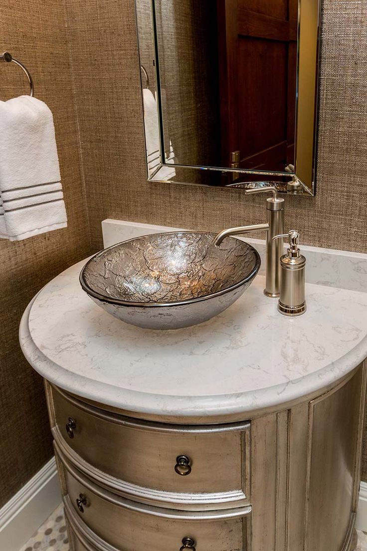 This serene bathroom features a Cambria quartz Torquay