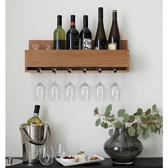 a spacesaving wall rack stores wine and glasses in farmhouse kitchen style