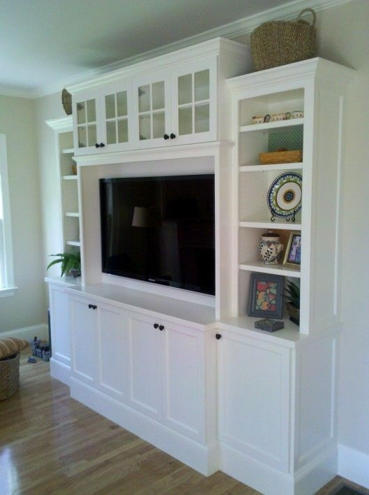 entertainment center (I like the glass doors at the top) simple design to go with batten board room