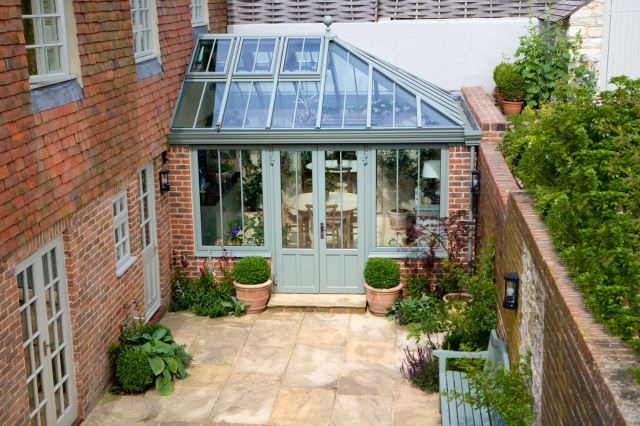 Orangery/conservatory. Clever use of space and garden walls.
