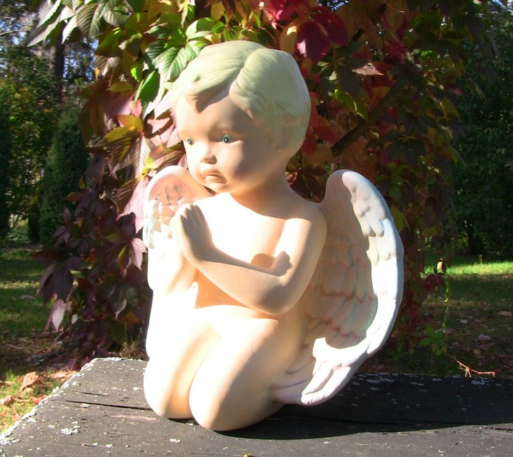 Beautiful ceramic angel is painted by hands.